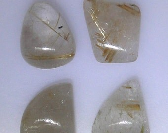 Four gold Rutile Quartz cabochons, various shapes and sizes,  89.08 carats
