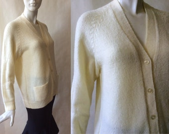 Vintage alpaca cardigan sweater, vee neck with button front and hip pockets, in buttery cream, made in Peru, about a medium / large