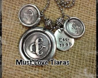 Anniversary wedding wax seal medallions two initials establish date ampersand