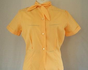 Vintage early 1960s crepe blouse light orange peach side necktie short sleeves size medium large Fritzi California