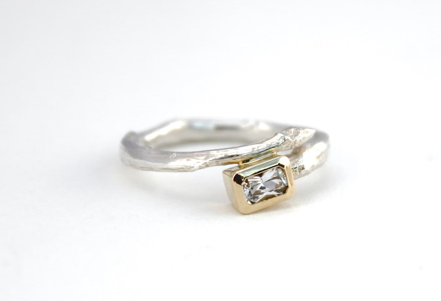 unique engagement ring emerald cut white sapphire twig