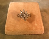 A Sterling Silver Ring with a Cluster of Prong Set Rhinestones...Size 8