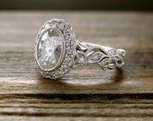 Oval Forever Brilliant Moissanite Engagement Ring in 14K White Gold with Diamonds in Flower Buds and Leafs Size 6