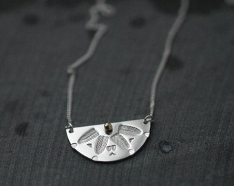 Cleopatra half moon silver necklace with dot of 14kt gold