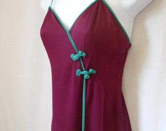 25% off with coupon code HOLIDAYHAPPINESS2. Vintage 1970s Ralph Montenero for Blanche gown Small/Medium. Burgundy, turquoise trim..