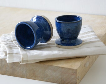 Set of two small drinking beakers - stoneware pottery glazed in midnight blue