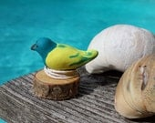Nautical Bird on Birch - Bird sculpted from clay sitting on a piece of the dock