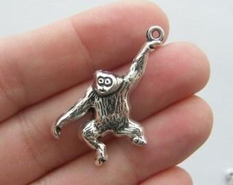 4 Orangutan pendants antique silver tone A213