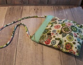 Bird medallion print  quilted shoulder bag in aqua, neon green and pink with mint green coordinating band across the top