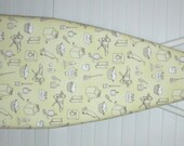 Ironing Board Cover - Laundry Room Theme on a  light yellow background.