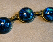 Steampunk Galaxy Dichroic Glass Bracelet - Antique brass green blue nebula constellation starmap - by ItsaWonderfulWall