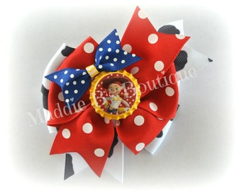 Toy Story Inspired-Jessie Cow Print pinwheel hair bow-Disney Toy Story Mania made by Maddie B's Boutique on Etsy