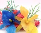 Mardi gras costume. Tiki drinks in the tropics fascinator.  Vintage plastic flowers.