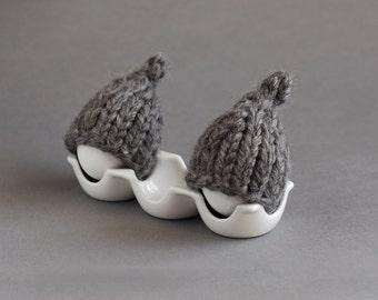 Dark grey egg warmers in rustic style
