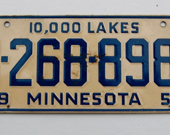 Vintage, mid-century bicycle license plate Minnesota Land of 10,000 Lakes 1954. Cream and Navy Blue.