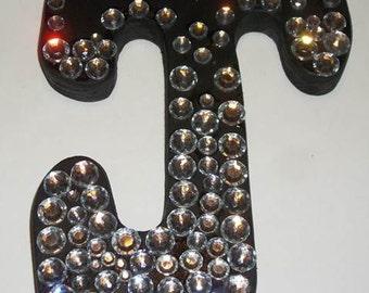 black wooden letter J with bling