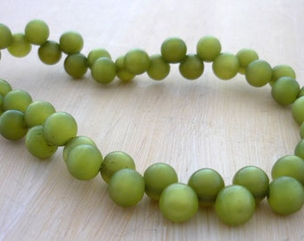 Vintage olive green lucite moonglow side drilled round beads 6mm