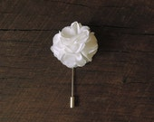 White peony wedding boutonniere for groom and groomsmen