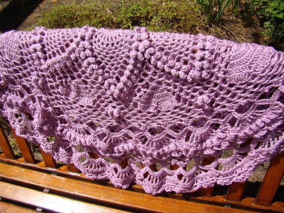 Queen-size crocheted circular afghan with hearts and pineapple popcorn stitching