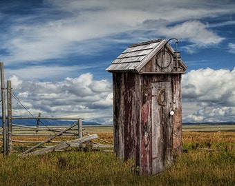 Vintage Outhouse out West by Wooden Fence against a Cloudy Sky No.074 Western Landscape Photography