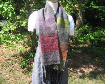 Warm hand-woven scarf in variegated shades from green to burgundy to blue with black fringe