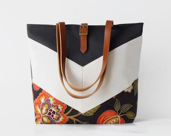 Dark navy blossom ivory chevron tote / diaper bag / shoulder bag, leather handles.  9 inside pockets. Waterproof poly lining available