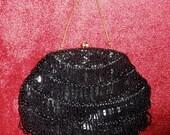 Vintage 1960s black fringe beaded evening handbag / clutch with golden chain handle