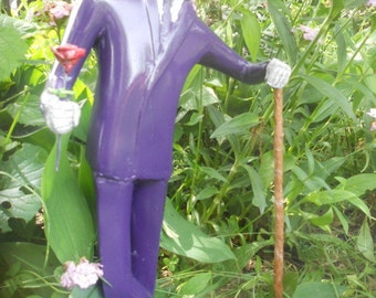 purple dude with shovel and flower sculpture outdoor figurine lawn garden decoration unusual art