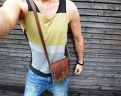 Day bag / small messenger bag in waxed canvas with leather flap and adjustable strap,COLLECTION UNISEX