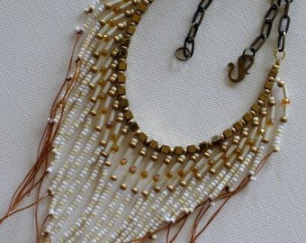 Native American necklace in gold, tan and white