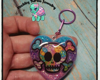 2 inch resin heart skull and crossbone pendant