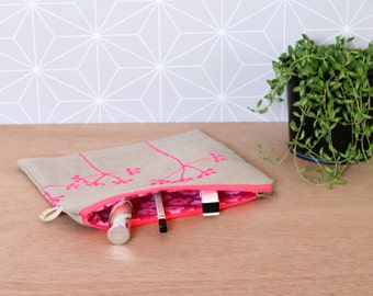 Neon pink clutch with flowers