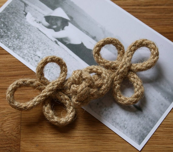 Unusual handmade woven jute cord 'frog' type fasteners, available in two different shapes - from the 1990s