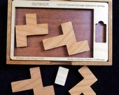 OUTBACK puzzle – insert all pieces into the large opening. Stewart Coffin design #222
