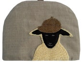 Sheep in tweed hat, large teapot tea cosy in cream
