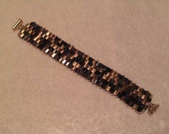 black / metallic dark bronze tila beads