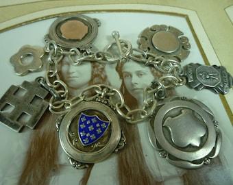 ANTIQUE sterling silver ENGLISH MEDAL vintage assemblage charn bracelet