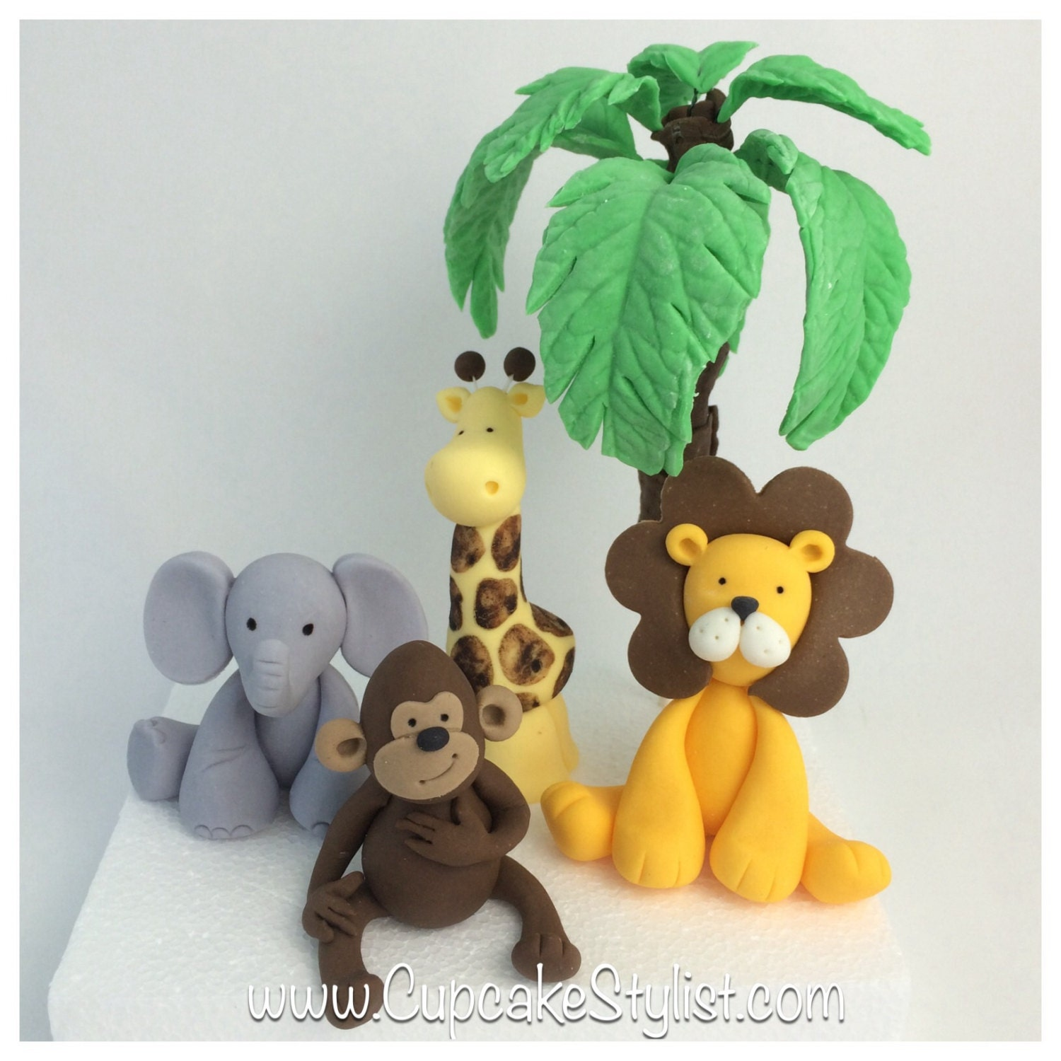 Gumpaste Safari animal and palm tree cake topper set by