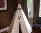 With my tribe ultimate indoor/outdoor 5 sided painted deer head Ivory teepee with stained wooden polls