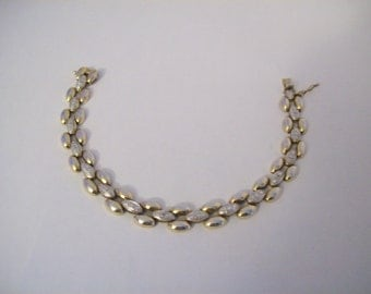 Gold 10k over sterling silver - Fits size 7 1/2