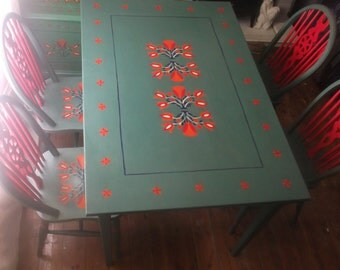 Dining room table and chairs with hand painted American folk art.