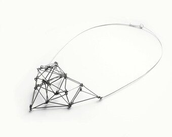 Geometric bib necklace of silver stainless steel Futuristika statement jewelry