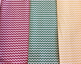 Fabric freedom ff47 construction collection chevron pattern in red, green or yellow by the half metre