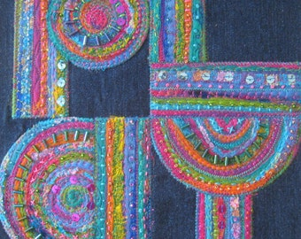Play: embroidered textile art on canvas