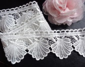 2 1/2 inch wide ivory embroidered lace trim selling by the yard