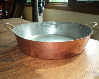Vintage Cooper Pan with two solid brass handles on each side with wonderful well developed patina in Very Good Shape, A Small Paella Pan