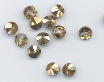 Twelve amazingly rare vintage Swarovski crystal beads: Art. 5102/20 - 8 mm - crystal comet OR - shiny gold