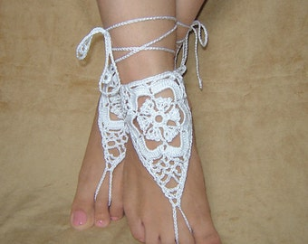 White triangle crochet  barefoot sandals.