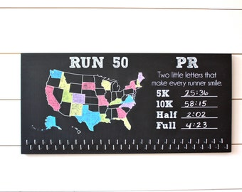 Run 50 States Medal Holder with PR Running Times list and 50 hooks onChalkboard