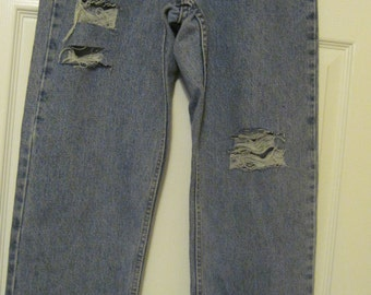 Levi's denim jeans upcycled Distressed//destroyed//frayed//ripped grunge Jeans size 27 High Waisted